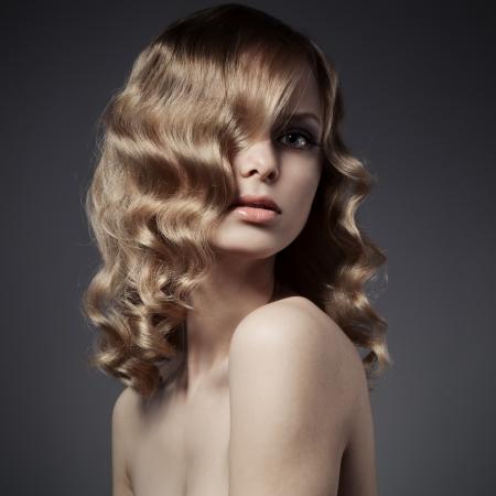 Beautiful Blond Woman. Curly Long Hair Stock Photo - 21976356