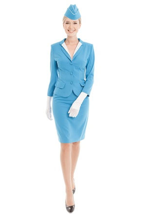 Charming Stewardess Dressed In Blue Uniform On White Background photo