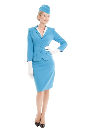Charming Stewardess Dressed In Blue Uniform On White Background Stock Photo