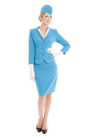 flug: Charming Stewardess in blauer Uniform auf weißem Hintergrund Gekleidet