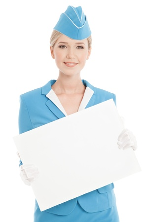 Charming Stewardess Dressed In Blue Uniform With Blank Form On White Background photo