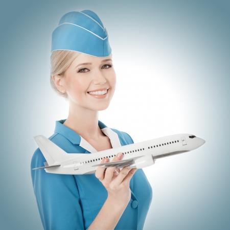 비행: 손에 매력적인 스튜어디스 지주 비행기. 스톡 사진