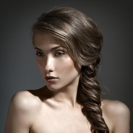 tress: Beautiful Woman Portrait. Long Brown Hair  Stock Photo