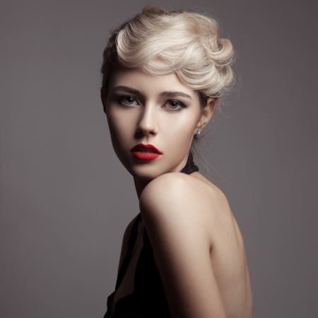 Beautiful Blonde Woman. Retro Fashion Image.