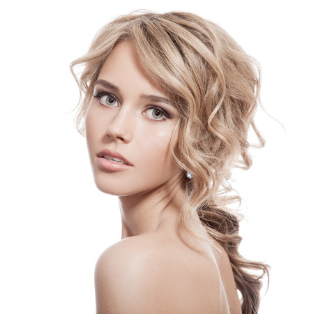 Beautiful Blonde Girl. Healthy Long Curly Hair. Фото со стока