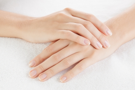Beautiful woman hands are on a towel Stock Photo - 23367870