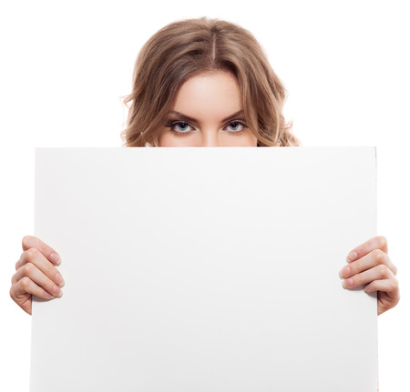 girl holding sign: Portrait of a young blond woman holding a white blank banner. Isolated