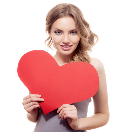 adult valentine: Valentines Day. Woman holding Valentines Day heart sign with copy space  Stock Photo