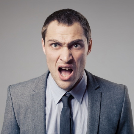 afraid man: Angry Businessman Screaming Stock Photo
