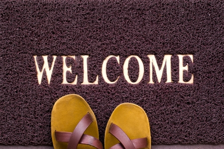 Welcome carpet with beach shales on it photo