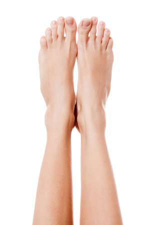 Close up image of woman bare feet. Isolated on white background