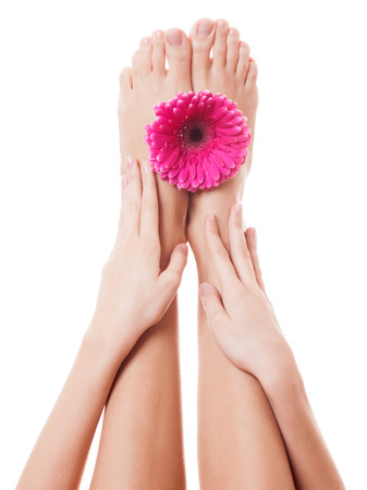 Close up image of woman bare feet. Isolated on white background  photo