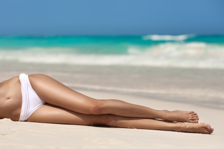 Womens sexy legs on the beach  Stock Photo