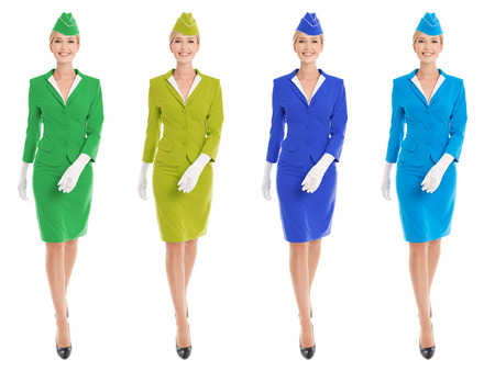 Charming Stewardess Dressed In Uniform With Color Variants. Isolated On White Background. photo