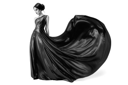Fashion woman in fluttering dress. Black and white image. Isolated on white background.  photo