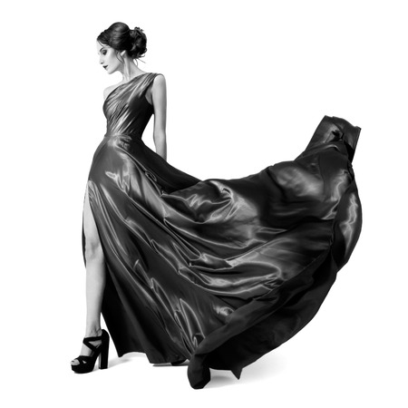 flyaway: Fashion woman in fluttering dress. Black and white image. Isolated on white background.  Stock Photo