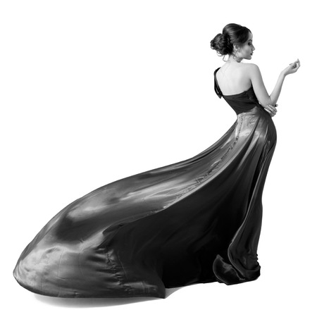 Fashion woman in fluttering dress. Black and white image. Isolated on white background.  Stok Fotoğraf