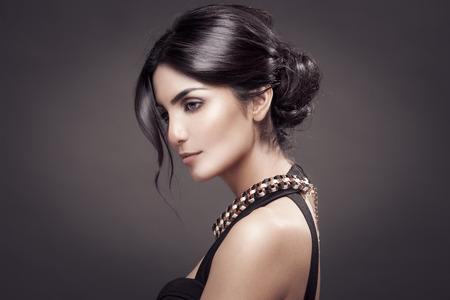 Fashion Portrait Of Beautiful Woman. Dark Background. Stock Photo