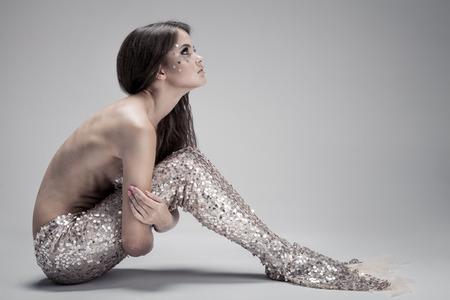 beautiful mermaid: Fashion Fantasy Mermaid. Studio Shot. Gray Background.