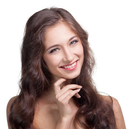 Portrait of attractive caucasian smiling brunette woman.  Isolated. Toothy smile face, long hair.  photo