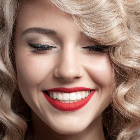 toothy: Close up face of beautiful Woman. Healthy Curly Hair. Gorgeous smile.