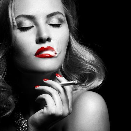Retro Portrait Of Beautiful Woman With Cigarette Stock Photo - 27475517