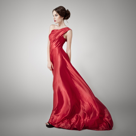 fluttering: Young beauty woman in fluttering red dress.