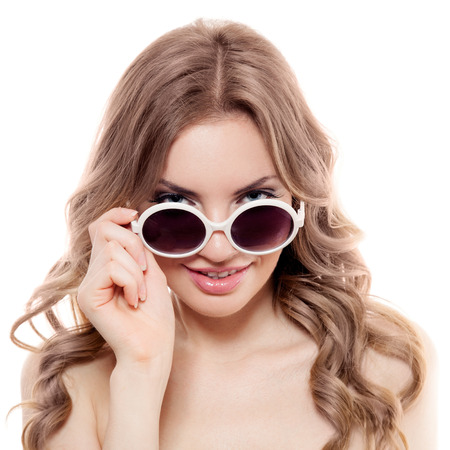 Fashion Woman With Sunglasses. Isolated  photo