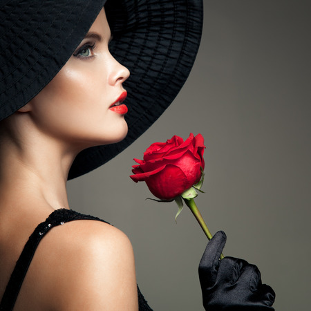 nude girl pretty young: Beautiful Woman With Red Rose. Retro Fashion Image. Stock Photo