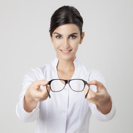 oculist: Smiling medical oculist woman. Stock Photo