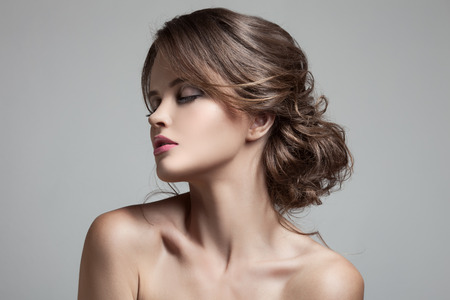 haircare: Beautiful Blond Woman. Hairstyle and Make-up. Stock Photo