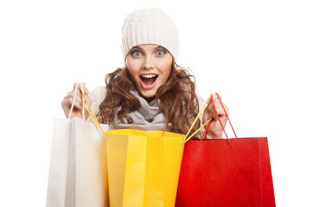 Shopping happy woman holding bags. Winter sales. Foto de archivo
