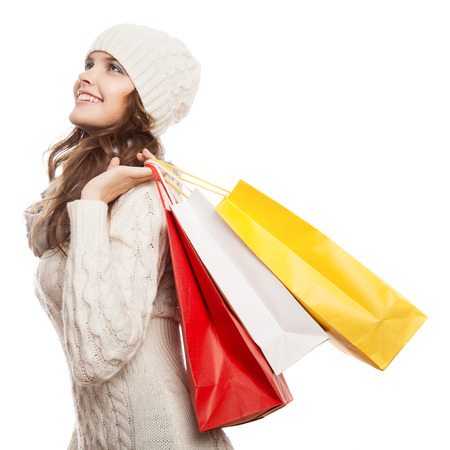 shopping spree: Shopping happy woman holding bags. Winter sales. Stock Photo