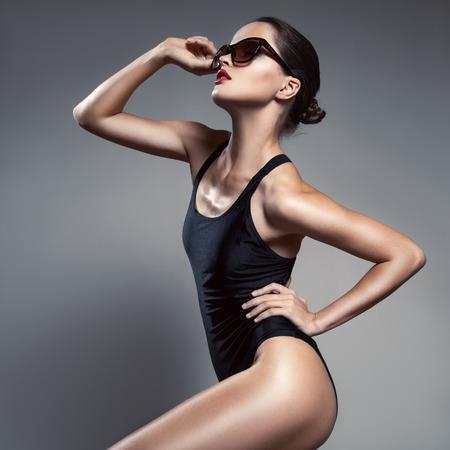 solarium: Fashion woman. Bikini and sunglasses. Stock Photo