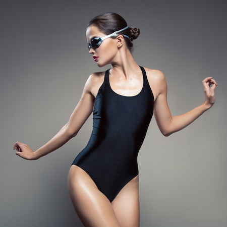 Fashion woman in swimsuit and swimming goggles. photo