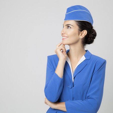 stewardess: Charming Stewardess Dressed In Blue Uniform Stock Photo