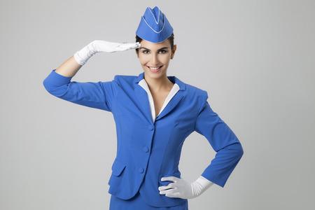 flight attendant: Charming Stewardess Dressed In Blue Uniform Stock Photo
