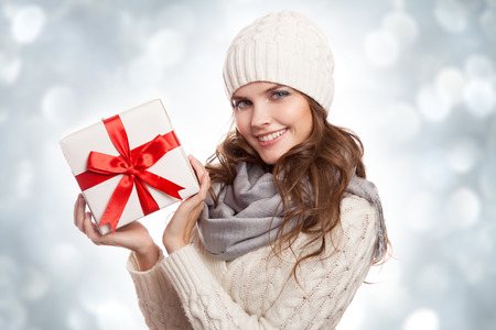 Young happy woman with a gift. Christmas. photo