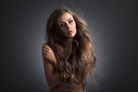 Beautiful Woman. Fluttering Long Hair. photo