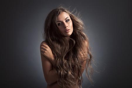 Beautiful Woman. Fluttering Long Hair. photo