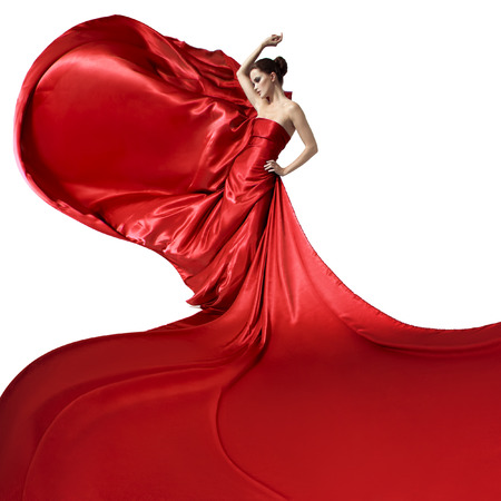 wind dress: Young beauty woman in fluttering red dress. Isolated on white background.