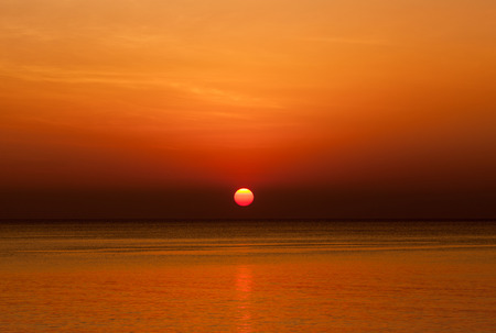 Scenic view of beautiful sunset above the sea photo