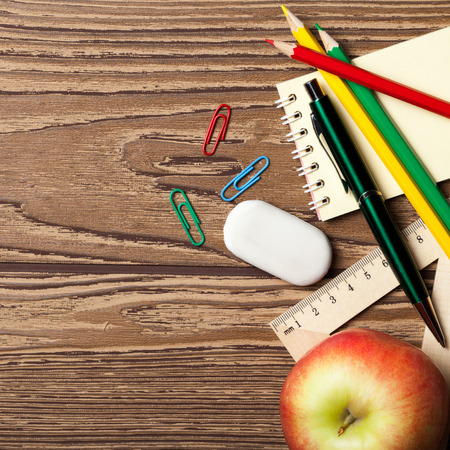 Back to school concept on wooden table. photo