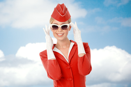 Charming Stewardess Dressed In Red Uniform And Vintage Sunglasses. Sky With Clouds Background. 版權商用圖片 - 33418466