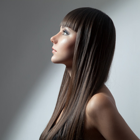 Hair. Beautiful Brunette Girl. Healthy Long Hair. Beauty Model Woman. Hairstyle photo