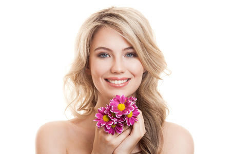 Portrait Of Beautiful Smiling Woman With Flowers. Clear Skin. photo