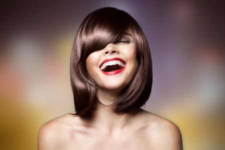 short cut: Smiling Beautiful Woman With Brown Short Hair. Haircut. Hairstyle. Fringe. Professional Makeup. Stock Photo