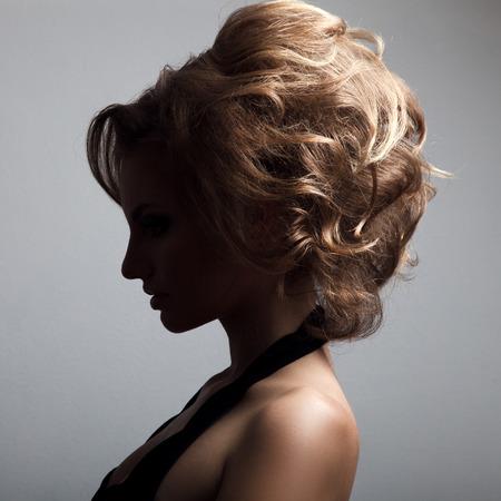 Beautiful Blonde Woman. Retro Fashion Image. photo