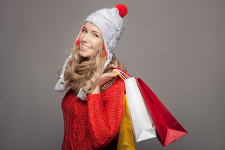 winter sales: Happy woman holding shopping  bags. Winter sales. Stock Photo