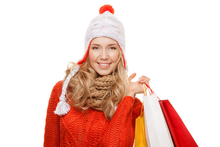 winter sales: Happy woman holding shopping  bags. Winter sales. Isolated.